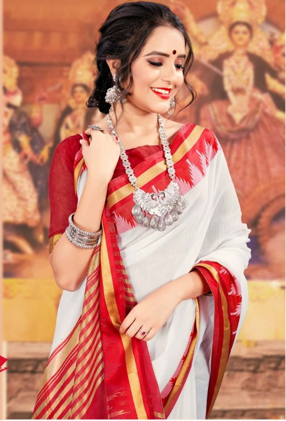 Red and White Sarees Celebrate Durga Puja