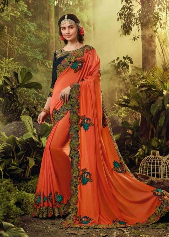 New trend designer orange color fancy silk saree with blouse online