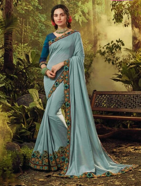 Best embroidered cream blue fancy saree with blouse with price.