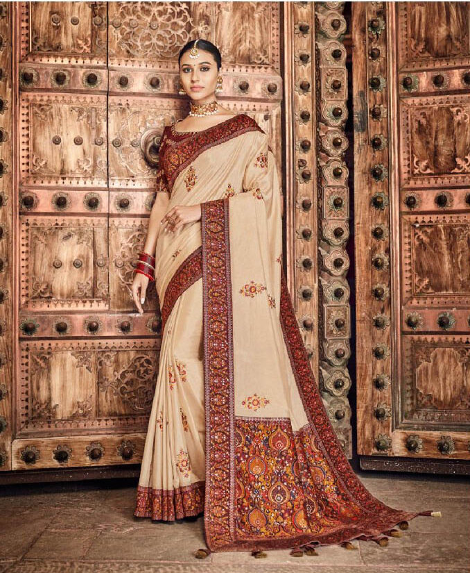 Best embroidered cream color dola silk saree with a maroon blouse