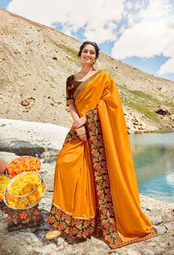 Best embroidered haldi occasion saree with contrast blouse.