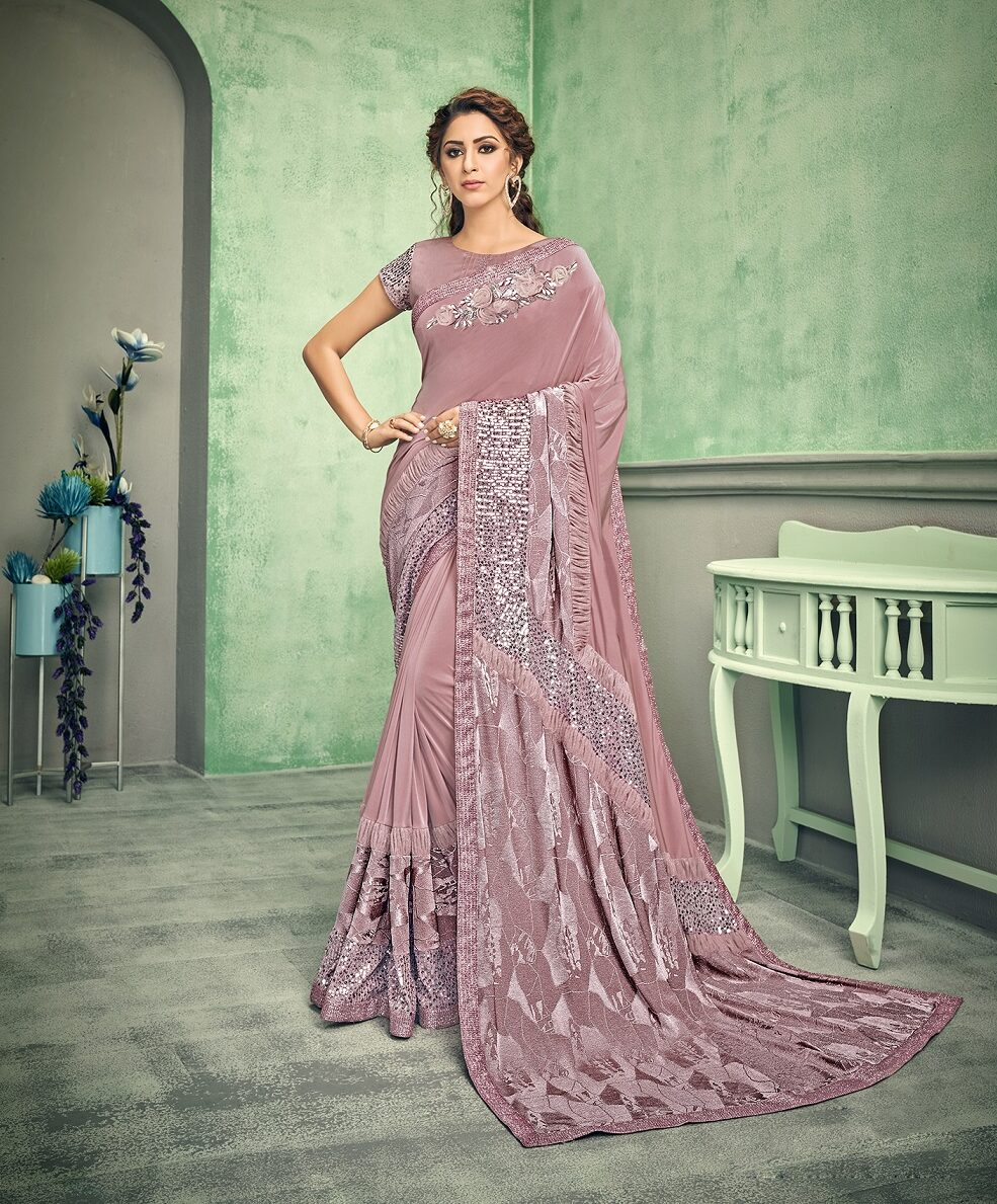 Best trendy embroidered designer light pink color saree with blouse.