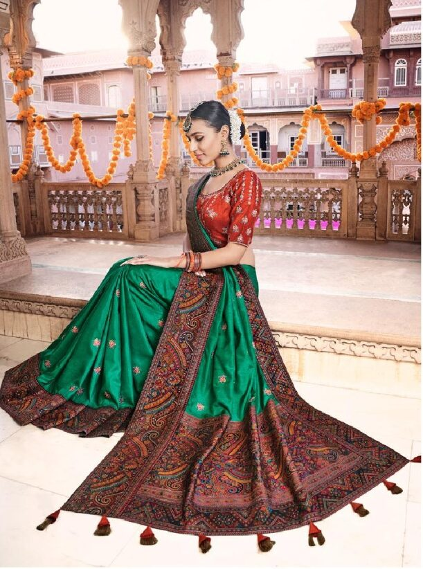 New designer dola silk green color bridal saree online.