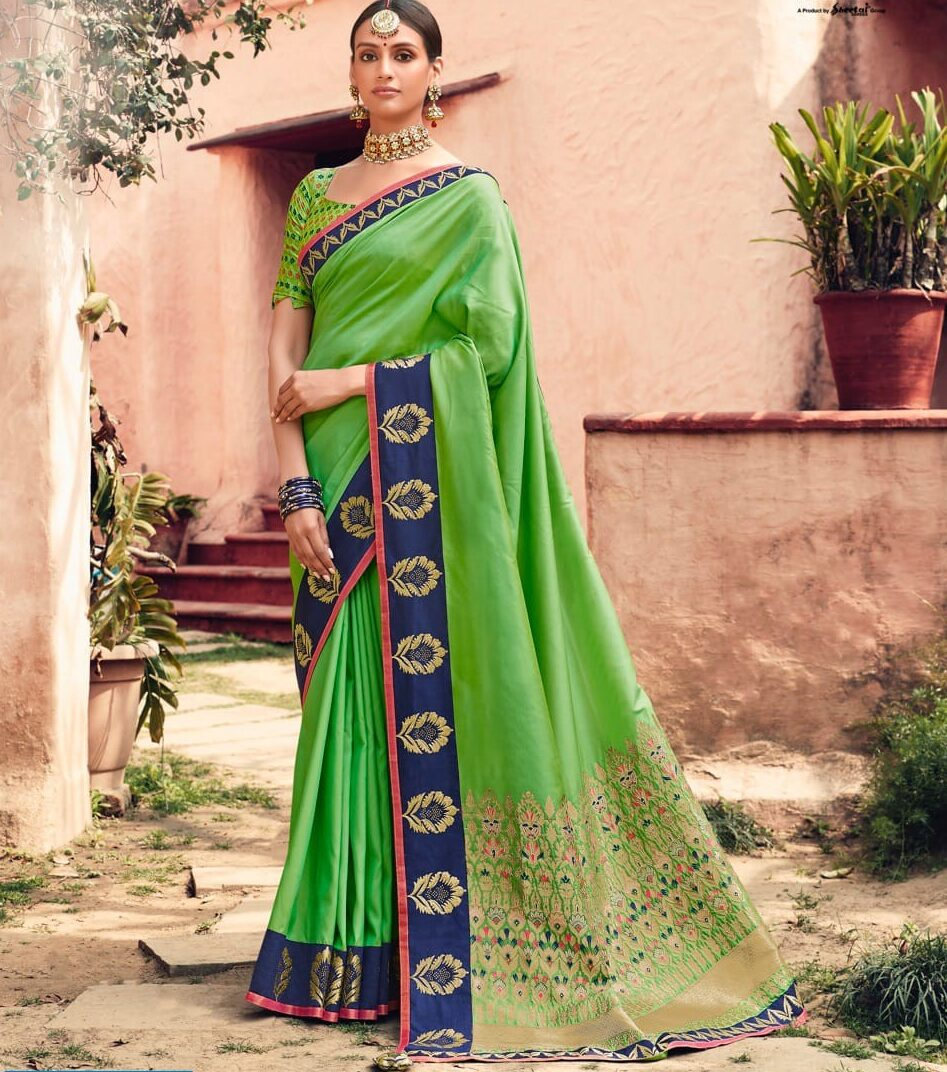 New designer green color a heavy wedding designer saree