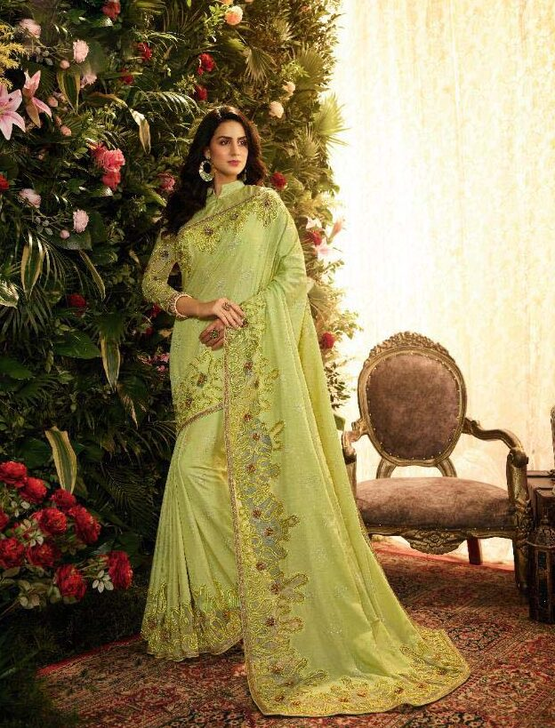 New designer light green color heavy embroidered silk saree with a price.