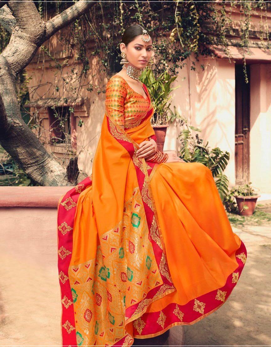 New designer orange color a heavy wedding designer saree.