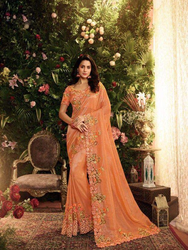 New designer orange color heavy silk saree with price.