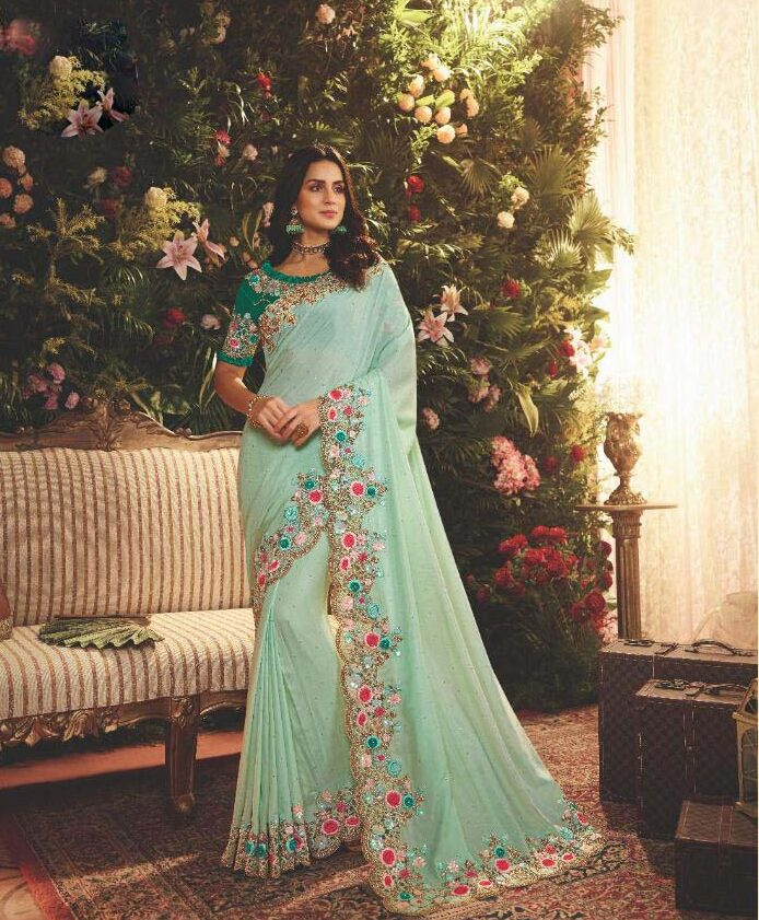 New designer sky blue color heavy silk saree with green blouse