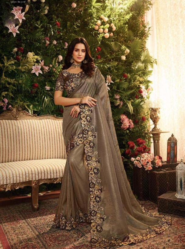 New trend designer gray color silk saree with heavy border.