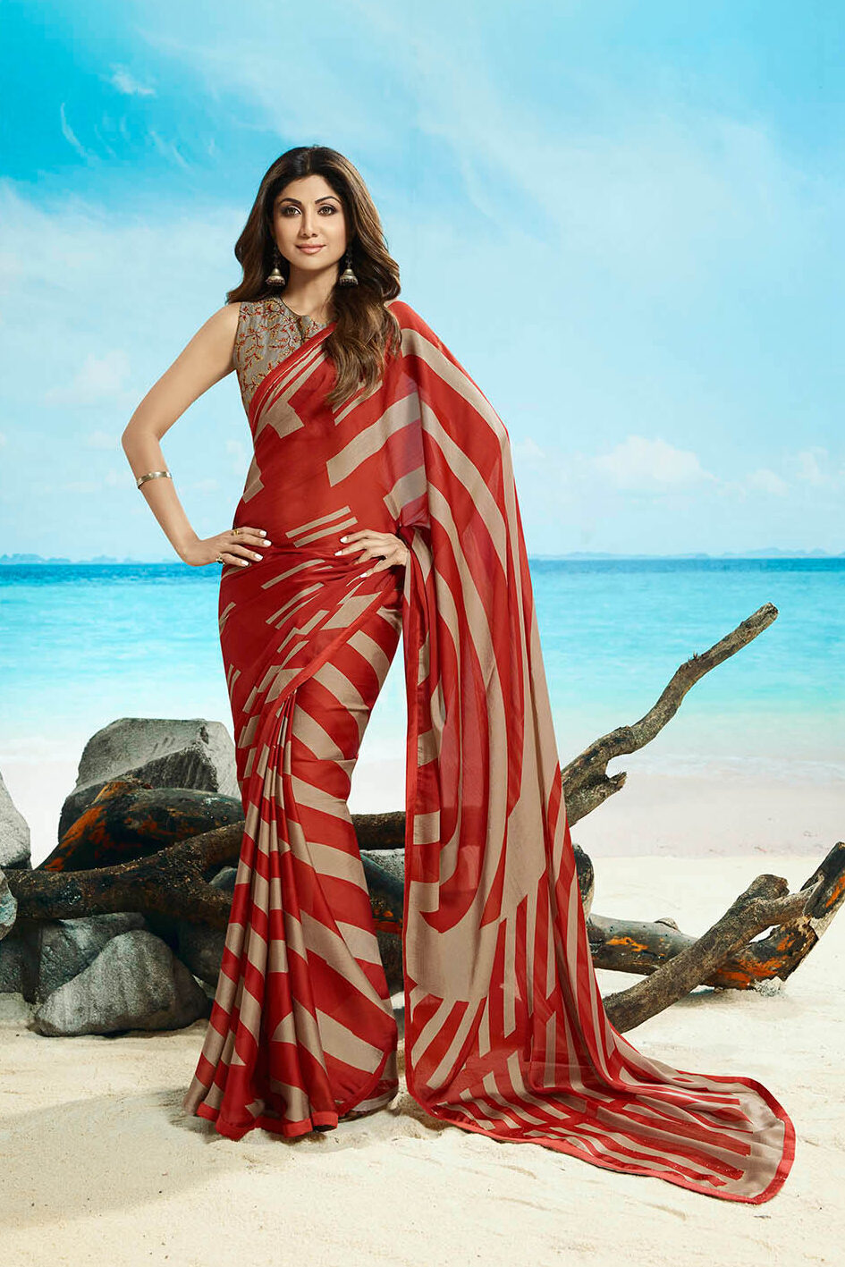 Best embroidered red color zebra design simple saree with designing blouse
